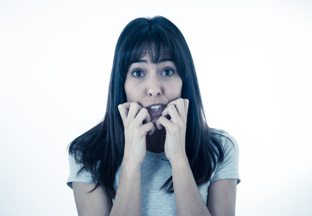 Close up of young woman feeling scared and shocked making fear, anxiety gestures. Looking terrified and desperate. People and Human expressions and emotions concept. Isolated on neutral background.