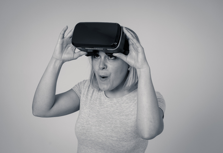 Curious amazed woman using augmented or virtual reality glasses, feeling excited about simulation, exploring virtual life making happy gestures. In goggles and Virtual and Augmented Reality concept.