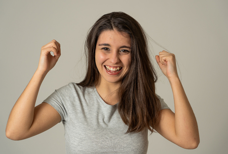 Portrait of beautiful shocked woman hearing good news, winning lottery or having great success with surprised happy face. Making cheerful gestures. Facial Expression, Human Emotions and celebration.