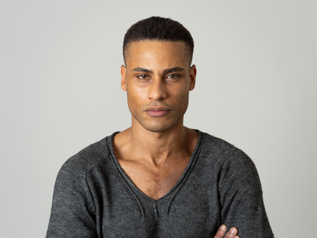Portrait of young attractive stylish african american man model posing in casual clothes against neutral background looking sexy with beautiful eyes. In People, Beauty and fashion concept.