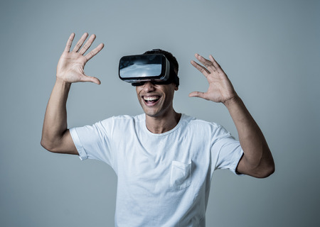 Amazed african american man using VR headset glasses, feeling excited about simulation, exploring virtual reality making gestures interacting with new virtual world. In new technology concept.