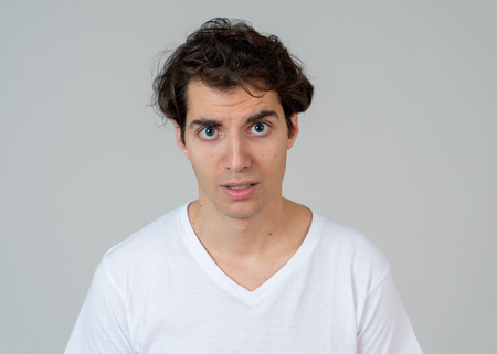 Thinking funny faces. Portrait of worried young man confused. Thoughtful male thinking in new ideas, creative ways to success, learning new languages or studying. Isolated on neutral background.