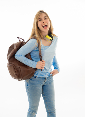 Beautiful millennial teenager girl with backpack and folder smiling and making happy and celebration gestures. Cheerful attractive student woman isolated on white background. In education and success.