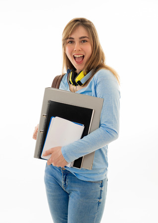 Beautiful teenager girl or young college student woman with backpack and folder smiling feeling happy and cheerful. Isolated on white background. University lifestyle success and end of school year.