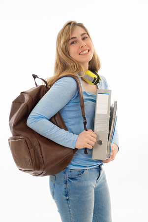 Beautiful teenager girl or young college student woman with backpack and folder smiling feeling happy and cheerful. Isolated on white background. University lifestyle success and end of school year. Stok Fotoğraf