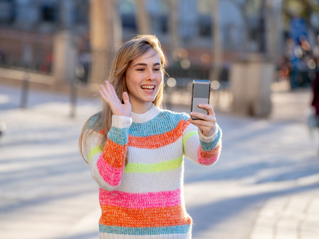 Pretty teenager woman happy and excited recording video for blog talking to followers or chatting in video call with friends or family. In technology Communications online Trends and Blogging. Stock Photo