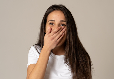 Portrait of beautiful shocked woman hearing good news or having great success with surprised and happy face. Making cheerful gestures. Facial Expression, Human Emotions and celebration. Copy space.