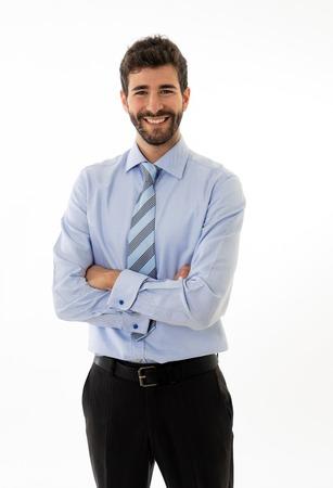 Halve lengte portret van een gelukkige, knappe blanke zakenman in een modern, formeel pak dat er zelfverzekerd en gastvrij uitziet. Geïsoleerd in het wit. Concept van mensen leiderschap en succes.