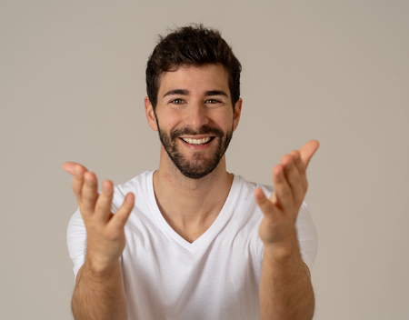 Portrait of Amazed excited funny Man achieving his goal or wining, laughing and making surprise gestures not believing his luck. In Happy face expression and Human emotions happiness. Imagens
