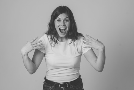 Human emotions and expressions. Portrait of beautiful shocked woman hearing unexpected news, winning or having great success with surprised and happy face making cheerful gestures. Studio shot. Imagens