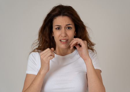 Portrait of young woman feeling scared and shocked making fear, anxiety gestures. Looking terrified and desperate. People and Human expressions, aggression, domestic violence and victim concept.