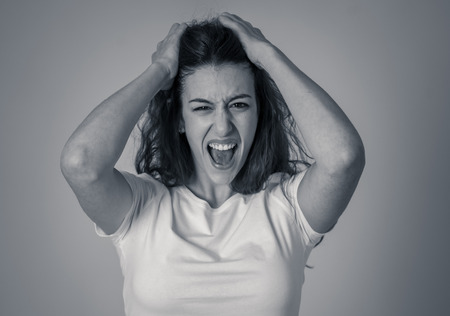 Portrait of beautiful shocked woman winning or having great success with surprised and happy face feeling so happy. In human Expressions Positive Emotions and success celebration. copy space.