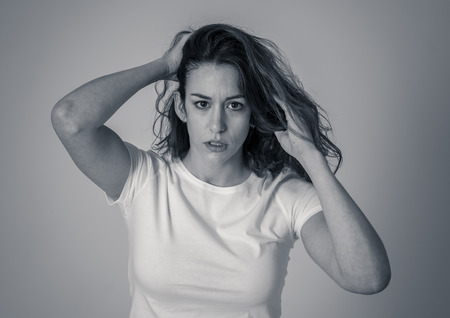 Black and white portrait of attractive frustrated caucasian woman with angry and stressed face looking mad and crazy shouting and making furious gestures. Copy space. Facial expressions and emotions. Фото со стока