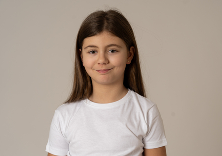 Close up portrait. Cute happy, confident, successful, proud little girl smiling at the camera. Positive human emotions, facial expressions, body languages and feelings. Studio shot.
