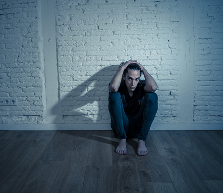 Devastated depressed millennial man crying sad feeling hurt suffering Depression. Teenager victim of bullying feeling lonely and depressed alone at home. Emotional pain Loneliness and Heartbroken.