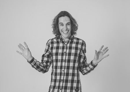 Portrait of young happy teenager man with funny hilarious faces having fun. Millennial male with long hair making silly amusing gestures isolated against neutral background. In facial expressions. Stok Fotoğraf