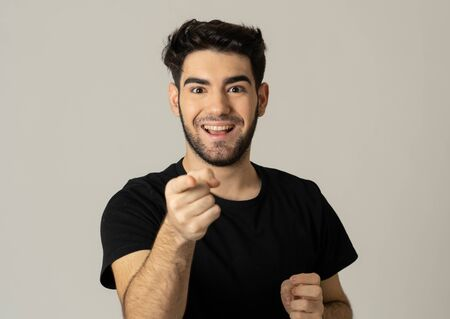 Portrait of a handsome latin young man surprised and shocked hearing great news. Attractive male looking amazed with wide eyes and mouth open in surprise. Human facial expressions and emotions. Reklamní fotografie