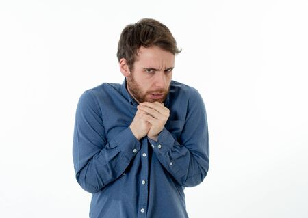 Portrait of young man in shock with scared face paralysed with fear and frightened face looking at something scaring. Human emotions feelings and facial expression. Isolated on neutral background. Banco de Imagens