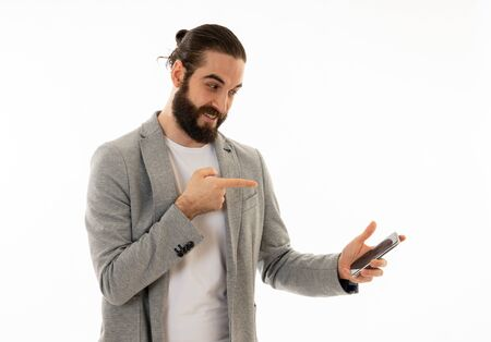 Hipster attractive man looking happily shocked at social media app video or blog. Surprised stylish man having lots of followers and likes online on social media network In internet and technology.