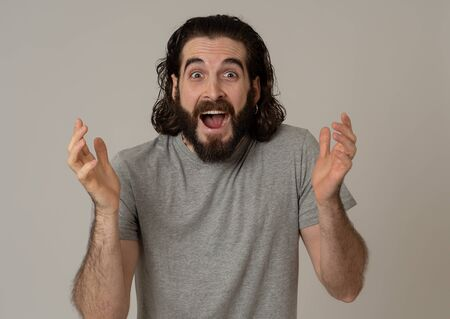 Portrait of funny attractive hipster man with happy and surprised face looking excited at something shocking good and unexpected. Human emotions and expressions Advertising, sales or winning concept.