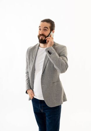 Portrait of young Hipster entrepreneur talking business on mobile smartphone feeling confident and successful. In people, freelance business communication and technology concept. Banco de Imagens - 124972985