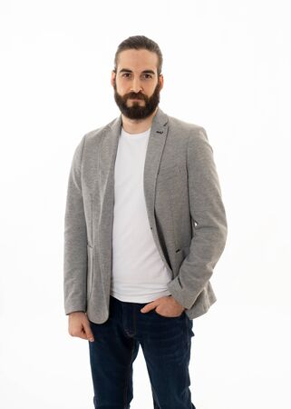 Portrait of confident handsome hipster entrepreneur man in fashion modern formal wear suit standing and looking confident and happy. Isolated on white background. Concept of leadership and success. Banco de Imagens - 124973011