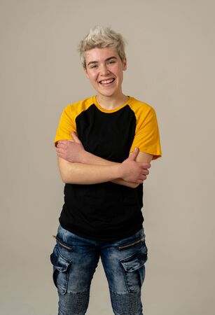 Portrait of attractive stylish fashion teenager confident and happy with his gender identity. Trans boy posing in cool urban fashion t shirt. In Beauty, Transgender people and Equality concept.
