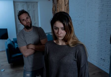 Social issues Domestic violence concept. Alcoholic and abuser partner beating and threatening his terrified wife. Violent man physically abusing scared girlfriend terrified of aggression and abuse.