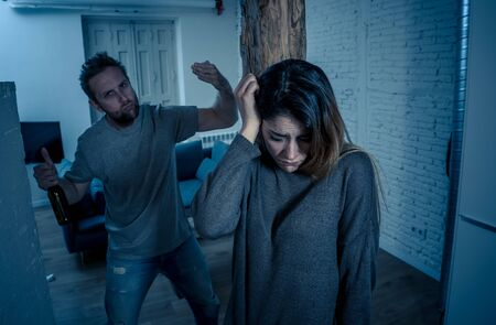 Social issues Domestic violence concept. Young couple having arguments and problems with alcoholic husband. Man threatening scared wife or girlfriend terrified of aggression and domestic abuse. Stock fotó - 125556519