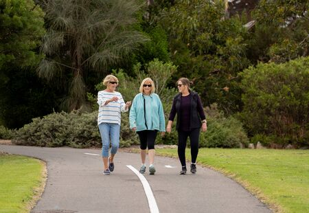 Lovely group of three senior mature retired women on their 60s walking in sportswear doing daily exercise routine together in People female friendship and active retirement healthy lifestyle concept.