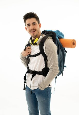 Portrait of happy cool latin man with backpack isolated on white background. In traveling the world, youth and living the dream, holidays student exchange and tourism and adventure vacation concept.