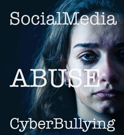 Dramatic closeup portrait of upset desperate girl bullied online suffering harassment crying and feeling intimidated. Child victim of cyberbullying,stalker, social media and dangers of the Internet.