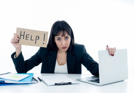 Young beautiful business woman suffering stress working at desk holding help sign feeling tired and frustrated looking overworked and overwhelmed. In business education, fail and technology concept.