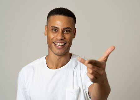 Close up portrait of a handsome african american man with a surprised and shocked face. Attractive male looking amazed with wide eyes and mouth open in surprise. Human facial expressions and emotions.