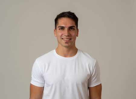 Portrait of attractive young model with happy face and beautiful smile. Handsome masculine millennial man in his 20s. Isolated on white. In People, fashion and human facial expressions and emotions.