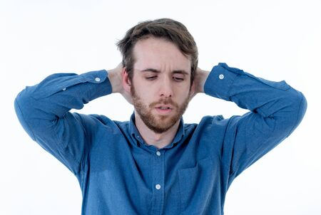 Young sad man suffering from depression. Worried and concerned hipster looking depressed and desperate feeling sorrow. Portrait with copy space. In People, human emotions and mental health concept.