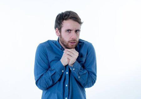 Portrait of young man in shock with scared face paralysed with fear and frightened face looking at something scaring. Human emotions feelings and facial expression. Isolated on neutral background. Imagens