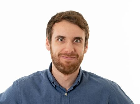 Portrait of funny attractive young man with happy and surprised face pointing and looking excited at something shocking and good. Human emotions, facial expressions. Advertising, sales or winning. Imagens