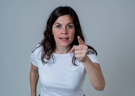 Facial expressions and emotions. Portrait of Young attractive caucasian woman with an angry face. Looking mad and crazy shouting and making furious gestures. Isolated on neutral background. Stockfoto
