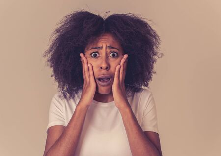 Portrait of frustrated african american woman with angry and stressed face. Looking crazy shouting and making furious gestures suffering anxiety. In Human emotions and expressions and mental health.