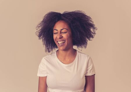 Close up portrait of attractive african american woman with happy face beautiful smile and afro hair. Isolated on neutral background. In People, positive human facial expressions and emotions. Banco de Imagens