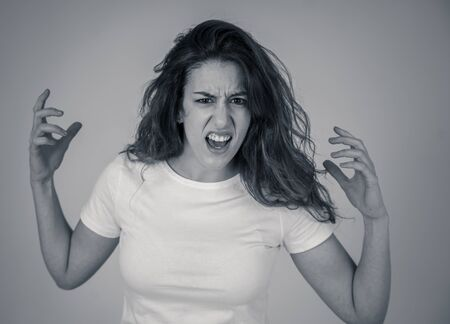 Black and white portrait of attractive frustrated caucasian woman with angry and stressed face looking mad and crazy shouting and making furious gestures. Copy space. Facial expressions and emotions. Stockfoto