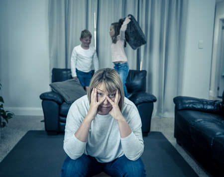 Stressed out parents struggling with having the children at home during Coronavirus self-isolation. Mother and father trying to cope with anxious kids during quarantine. COVID-19 Health crisis impact.