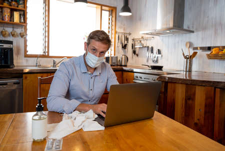 COVID-19 Online medical Consultation. Sick man with mask connecting with doctor on video call. Online Patient talking to physician for medical advice on treatment of coronavirus disease symptoms.