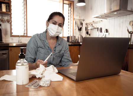 COVID-19 Online medical Consultation. Sick Woman with mask connecting with doctor on video call. Online Patient talking to physician for medical advice on treatment of coronavirus disease symptoms.