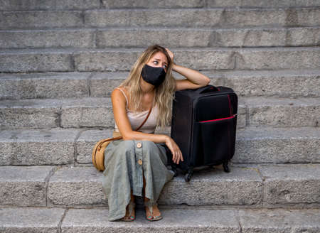 COVID-19 impact in international tourism. Sad tourist woman worried about coronavirus quarantine back home amid new travel regulations. Vacations cancellations due to coronavirus travel restrictions. Stok Fotoğraf