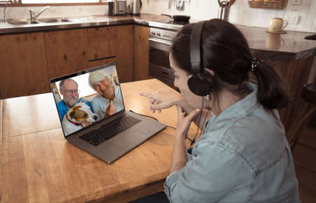 Second COVID-19 wave, Stay connected during quarantines and New Normal concept. Happy young woman video calling friends or Keeping in touch with family while in self isolation and new lockdown.