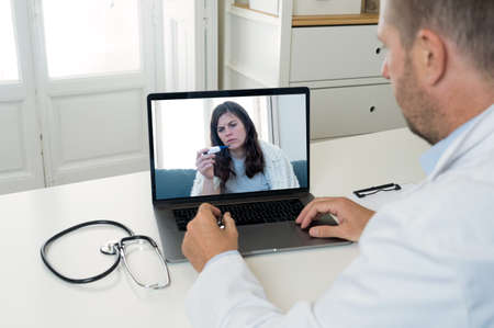 Online medical consultation. Screen laptop with Sick woman video calling physician for medical treatment. Medicine online, virtual appointment with online doctor getting health advice for Coronavirus.