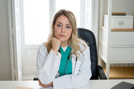 Young attractive caucasian woman doctor interacting with patient in online video consultation, screen point of view or close up. Telemedicine, Health care and technology.