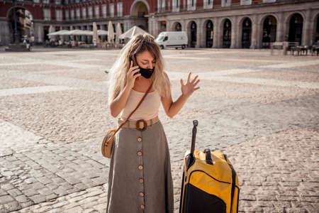 Unhappy tourist not able to travel abroad due to Post-pandemic Travel restrictions. Woman about to go on summer vacations tested positive for  virus   or flight was canceled.